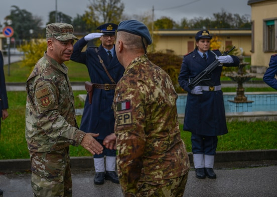 U.S. Air Force Gen. Jeffrey L. Harrigian, U.S. Air Forces in Europe and Air Forces Africa commander, shakes hands with an Italian Air Force member at Aviano Air Base, Italy, Nov. 15, 2019. Gen. Harrigian has served in a variety of flying and staff assignments, including Deputy Director for Strategy, Plans and Assessments, U.S. Forces-Iraq, in support of Operation Iraqi Freedom and as Chief of the Joint Exercise Division at NATO's Joint Warfare Center, Stavanger, Norway. (U.S. Air Force photo by Airman Thomas S. Keisler IV)