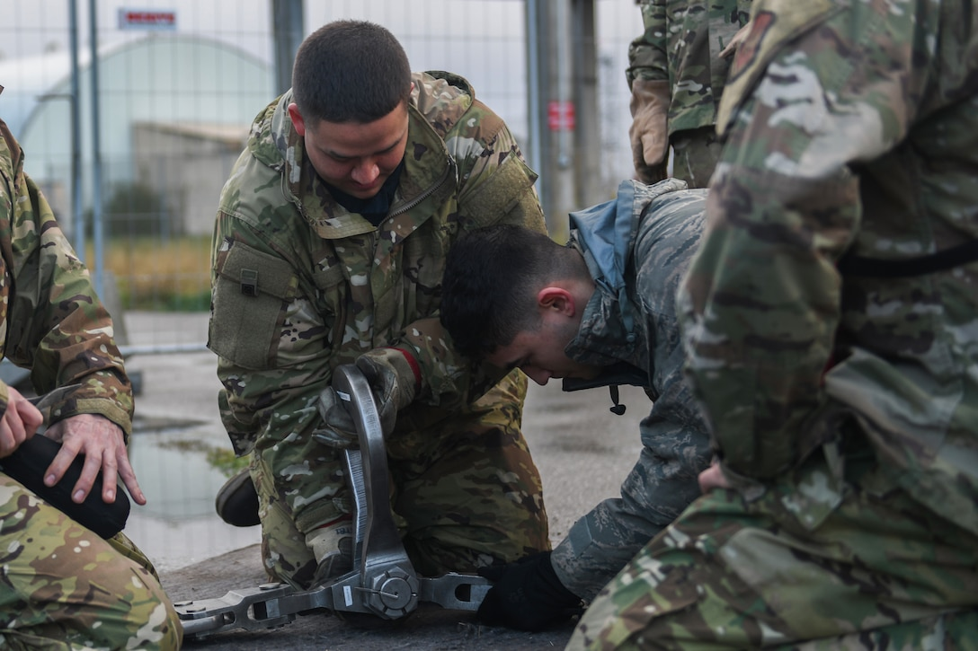 U.S. Airmen from the 31st Maintenance Squadron prepare a lifting sling at Aviano Air Base, Italy, Nov. 16, 2019. The 31st MXS provides accessory maintenance, avionics, periodic phase inspections, fabrication, and aerospace ground equipment for 50 assigned aircrafts. (U.S. Air Force photo by Airman 1st Class Ericka A. Woolever).