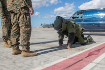 U.S. Marine with Special Purpose Marine Air-Ground Task Force-Crisis Response-Africa 20.1, Marine Forces Europe and Africa, conduct familiarization with the explosive ordnance disposal bomb suit at Morón Air Base, Spain, Nov. 7, 2019. SPMAGTF-CR-AF is deployed to conduct crisis-response and theater-security operations in Africa and promote regional stability by conducting military-to-military training exercises throughout Europe and Africa. (U.S. Marine Corps photo by Cpl. Kenny Gomez)