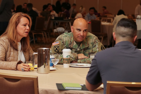 Maj. Gen. Alberto Rosende, commanding general of the 63rd Readiness Division, and his wife, Martha, talk to an Army Reserve Soldier and his spouse at a Yellow Ribbon event in Anaheim, California, Nov. 16, 2019.