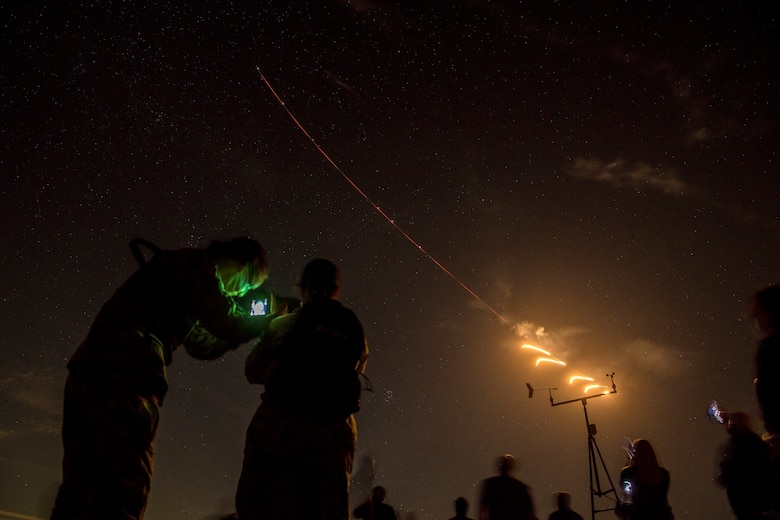 Luke Air Force Base honorary commanders and Airmen watch F-16 Fighting Falcons assigned to the 310th Fighter Squadron, conduct night operations during a tour Nov. 14, 2019, at the Barry M. Goldwater Range, Ariz.