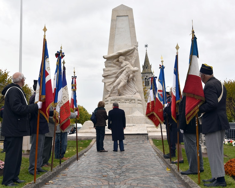 Issoudun mayor André Laignel (center) stands before a newly reconditioned war memorial alongside the memorial creator Ernest Nivet's daughter during an Armistice Day commemoration Nov. 11, 2019, in Issoudun, France. Airmen from the 32nd Aerial Refueling Squadron at Joint Base McGuire-Dix-Lakehurst, New Jersey, attended the ceremony to help commemorate the day and honor fallen Airmen who were stationed at the 3rd Aviation Instruction Center during World War I. (U.S. Air Force photo by Tech. Sgt. Chris Powell)