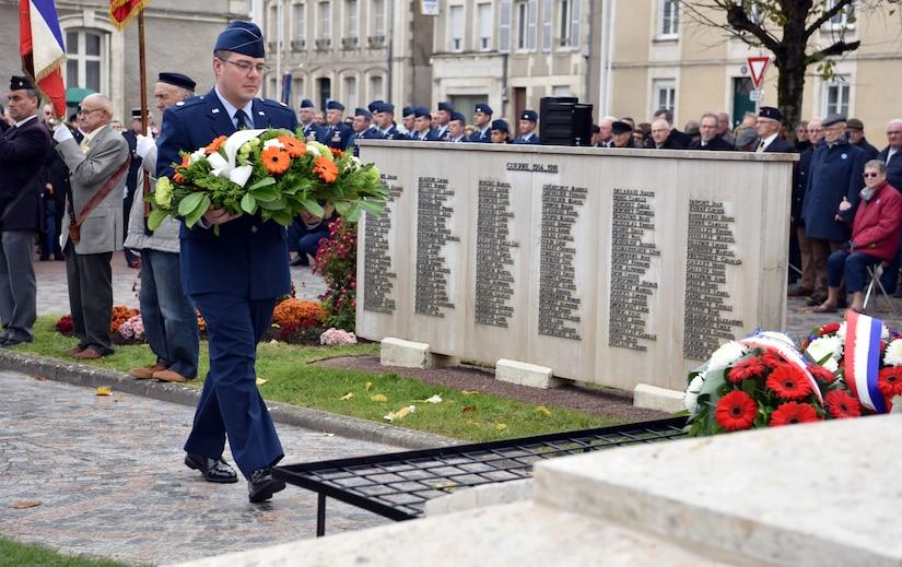 U.S. Air Force Maj. John Cockburn, 32nd Aerial Refueling Squadron operations officer, lays a wreath during an Armistice Day commemoration Nov. 11, 2019, in Issoudun, France. During World War I, the 32nd ARS was known as the 32nd Aero Squadron and was assigned to the 3rd Aviation Instruction Center, where they supported American pilot training. The 32nd AS lost five Airmen during the war. (U.S. Air Force photo by Tech. Sgt. Chris Powell)