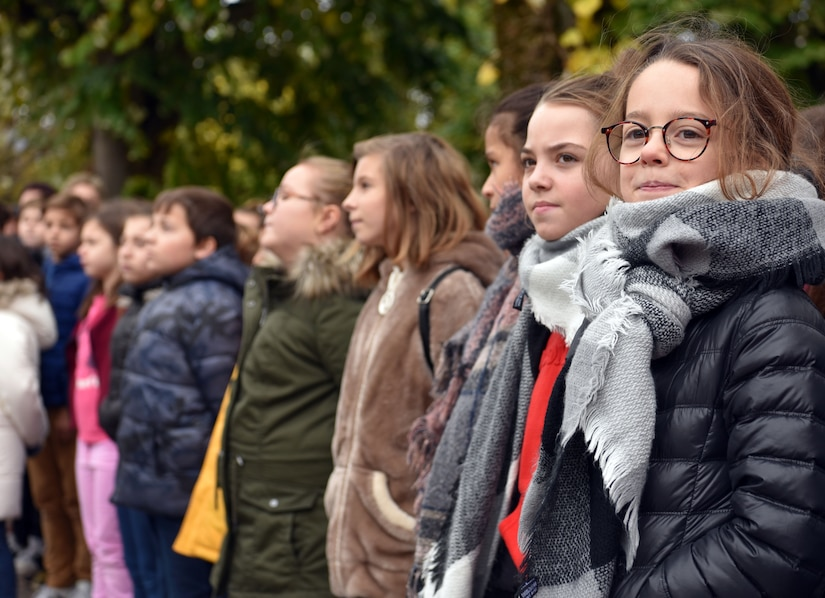 Local school children look on during an Armistice Day commemoration Nov. 11, 2019, in Issoudun, France. Armistice Day is commemorated annually to mark the armistice signed between the Allies and Germany for the end of hostilities during World War I. (U.S. Air Force photo by Tech. Sgt. Chris Powell)