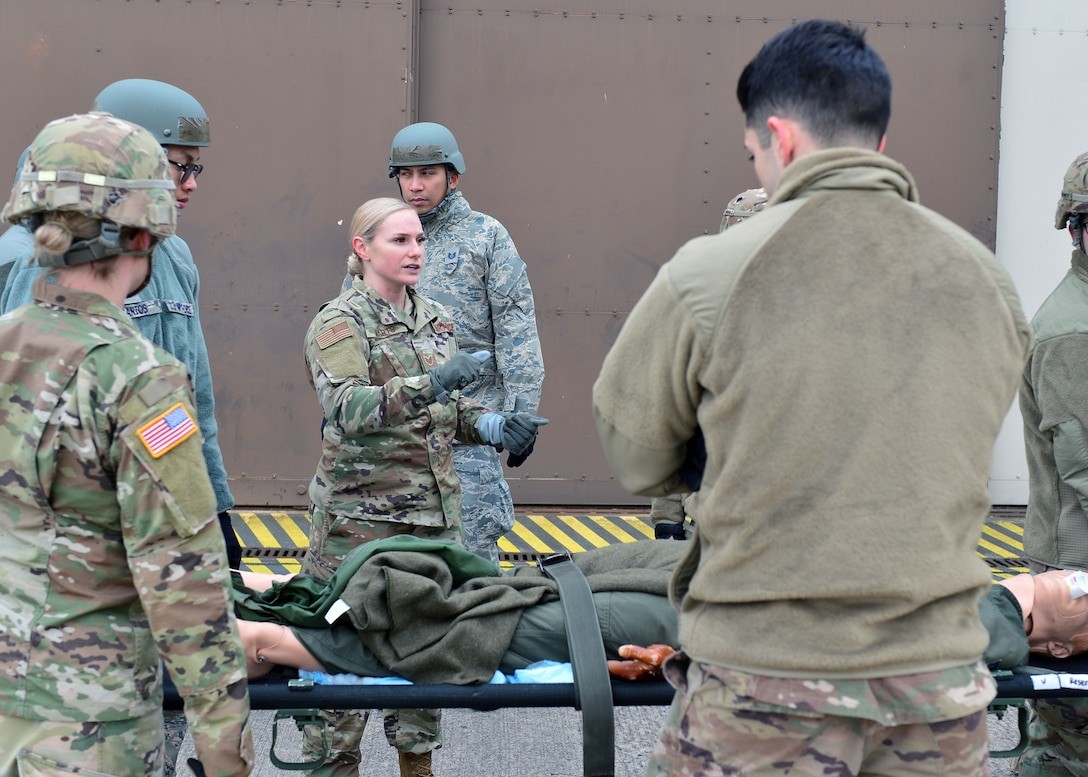 U.S. Air Force Staff Sgt. Bianca Marts, 86th Aerospace Medicine Squadron NCO in charge of Enroute Patient Staging mission management, provides instruction to Airmen and Soldiers for coordinating litter movements and loading litters onto a truck at Ramstein Air Base, Germany Nov. 15, 2019. Movements while carrying a litter should be carefully coordinated to ensure no further injury is caused during patient transport. (U.S. Air Force photo by Staff Sgt. Jimmie D. Pike)