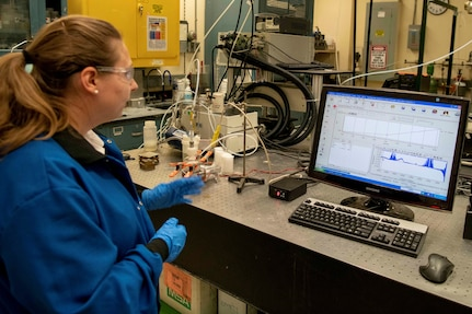 Naval Research Lab Chemical Engineer Katherine Hinnant tests an experimental aqueous film-forming foam at the NRL in Washington, Sept. 23, 2019. NRL scientists are conducting research to support the Defense Department's effort to replace firefighting foams containing fluorine.