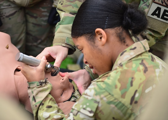 U.S. Army Spc. Krystal Robinson, 212th Combat Support Hospital licensed practical nurse, practices an intubation method at Ramstein Air Base, Germany, Nov. 15, 2019. During a joint medical training event, Soldiers and Airmen assigned throughout the Kaiserslautern Military Community were able to share knowledge and skills to improve on capabilities. (U.S. Air Force photo by Staff Sgt. Jimmie D. Pike)