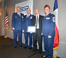 Col. Terry W. McClain, 433rd Airlift Wing commander; Chief Master Sgt. Andrew Branning, 433rd AW administration functional manager; Mark Middleton, CloudWave VIP of cloud services; and Chief Master Sgt. Shana C. Cullum, 433rd AW command chief, pause for a moment following the ESGR Salute to Employers Awards luncheon Nov. 13, 2019 in San Antonio.