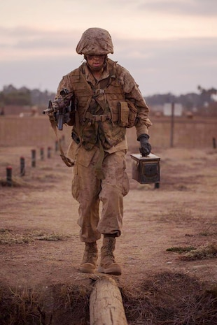 A recruit with Delta Company, 1st Recruit Training Battalion, runs across a log during the crucible at Marine Corps Base Camp Pendleton, California, Nov. 6, 2019.
