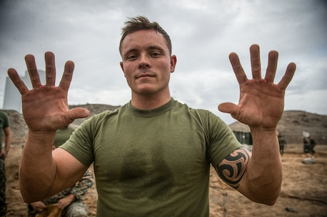 U.S. Marine Corps Sgt. Jacob Wright, motor vehicle operator assigned to Special Purpose Marine Air-Ground Task Force Crisis Response-Central Command 19.1, shows blisters sustained from utilizing an entrenching tool