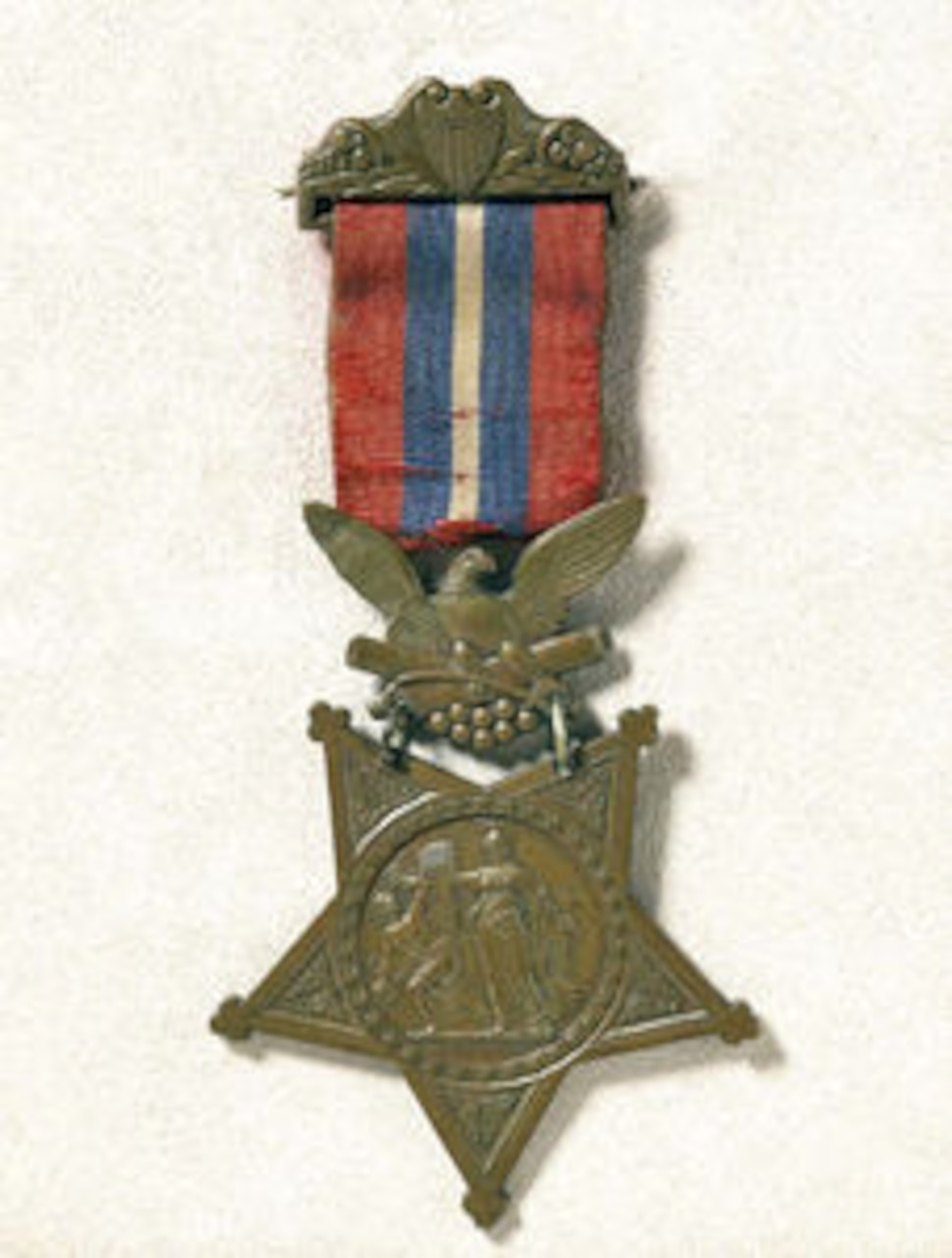 A Civil War-era Medal of Honor with red, white and blue ribbon.