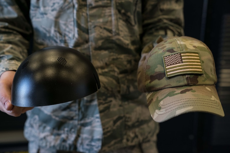 Tech. Sgt. Haisen Exon, 90th Missile Maintenance Squadron, Facilities Maintenance Section, support section NCOIC, shows the bump cap insert and how it inserts into a normal cap on F.E. Warren AFB, Wyoming, Nov. 18, 2019. He teams up with the 90th Missile Wing LaunchWerx agency to bring forward an idea to prevent future head injuries across the wing. (U.S. Air Force photo by Joseph Coslett)