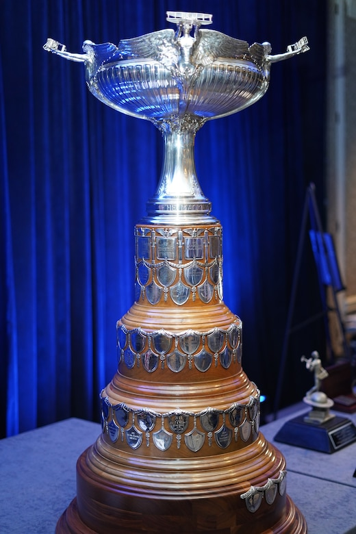 A trophy sits on top of a table.