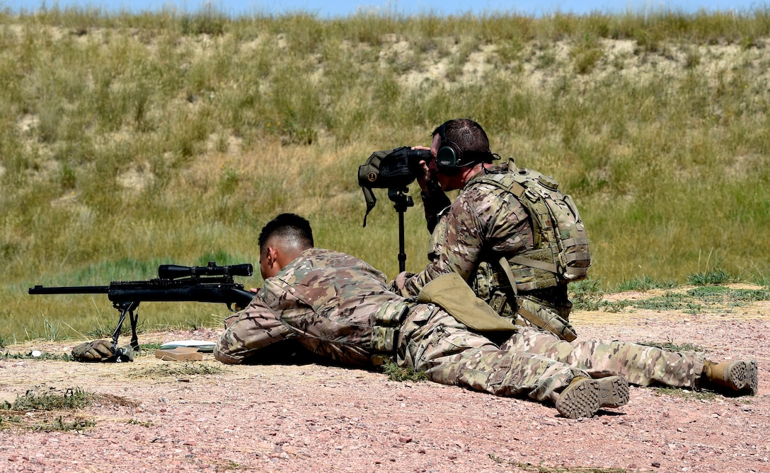 Staff Sgt. Justin McMahon, 90th Missile Security Forces Squadron flight security controller, assures the shooter, Senior Airman Jonne Cadua, 90th Security Support Squadron tactical response force assaulter, is on target during the 2019 Global Strike Challenge, Aug. 7, 2019, at Camp Guernsey, Wyo. Global Strike Challenge is the world's premiere bomber, ICBM, helicopter operations and security forces competition. (U.S. Air Force photo by Tech Sgt. Tyler Placie)