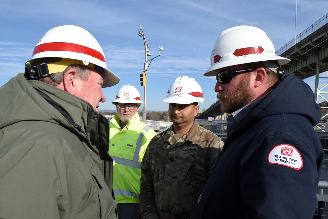 Tommy Long (Left), U.S. Army Corps of Engineers Nashville District resident engineer, gives an update on the Chickamauga Lock Replacement Project while overlooking ongoing construction to R.D. James, assistant secretary of the Army for Civil Works, during a walking tour Nov. 14, 2019 at Chickamauga Lock on the Tennessee River in Chattanooga, Tenn. (USACE photo by Lee Roberts)