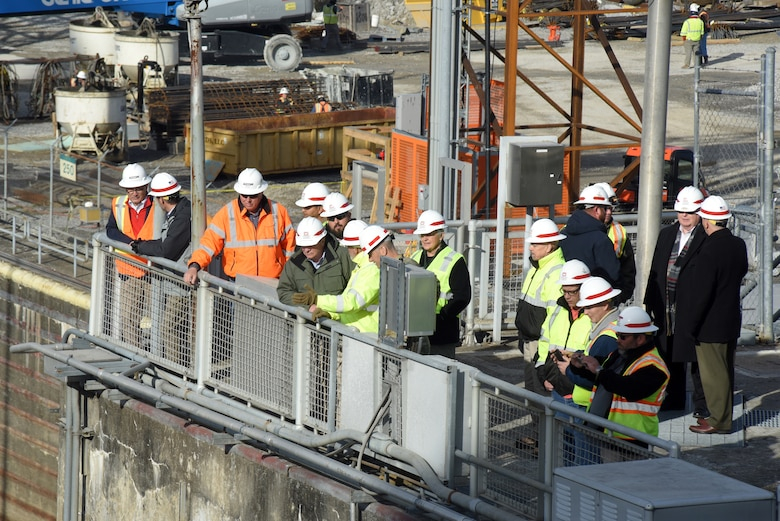 R.D. James (green coat), assistant secretary of the Army for Civil Works, overlooks ongoing work to place concrete and construct a new navigation lock during a walking tour Nov. 14, 2019 at Chickamauga Lock on the Tennessee River in Chattanooga, Tenn. The Nashville District is constructing a new 110-foot by 600-foot navigation lock at the Tennessee Valley Authority project. (USACE photo by Lee Roberts)