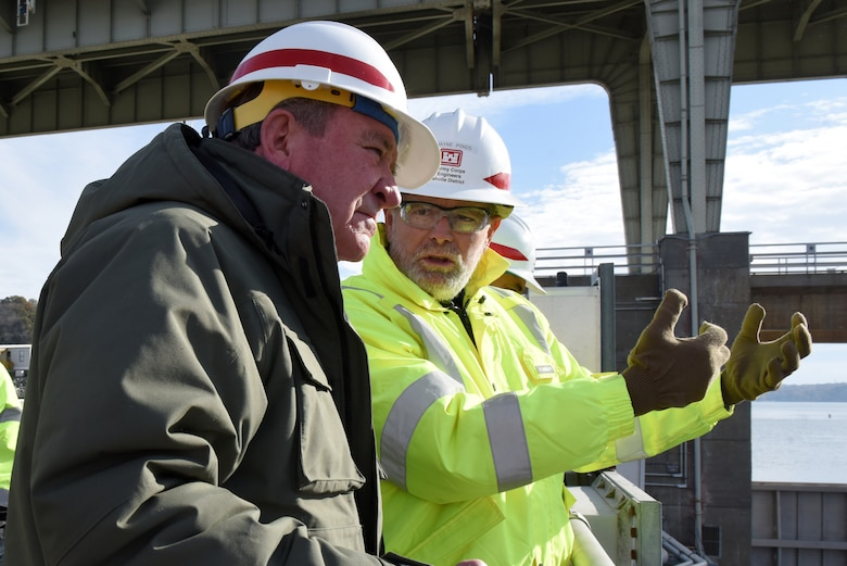 Dwayne Ponds (Right), U.S. Army Corps of Engineers Nashville District project geologist, explains the ongoing work to place concrete and construct a new navigation lock to R.D. James, assistant secretary of the Army for Civil Works, during a walking tour Nov. 14, 2019 at Chickamauga Lock on the Tennessee River in Chattanooga, Tenn. The Nashville District is constructing a new 110-foot by 600-foot navigation lock at the Tennessee Valley Authority project. (USACE photo by Lee Roberts)