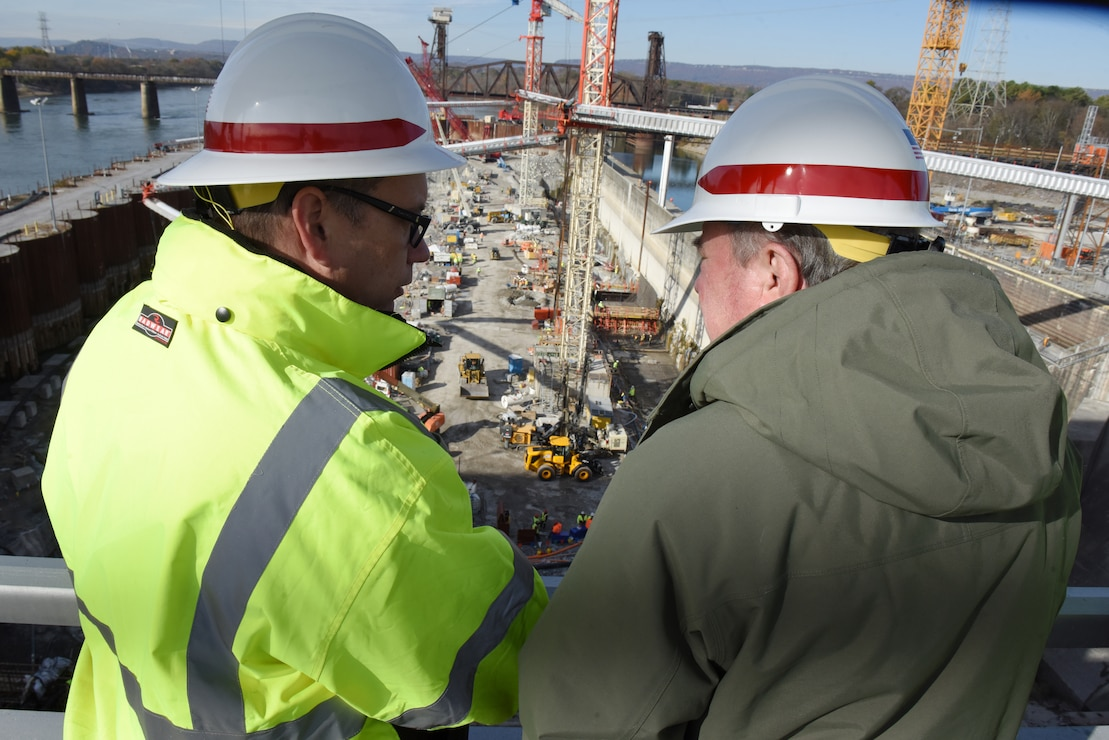 Tommy Long (Left), U.S. Army Corps of Engineers Nashville District resident engineer, gives an update on the Chickamauga Lock Replacement Project while overlooking ongoing construction to R.D. James, assistant secretary of the Army for Civil Works, during a walking tour Nov. 14, 2019 at Chickamauga Lock on the Tennessee River in Chattanooga, Tenn. The Nashville District is constructing a new 110-foot by 600-foot navigation lock at the Tennessee Valley Authority project. (USACE photo by Lee Roberts)