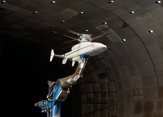 A scale model of the Sikorsky-Boeing SB>1 DEFIANT™ undergoes testing at the AEDC National Full-Scale Aerodynamics Complex at Moffett Field in Mountain View, California. The goal of the wind tunnel test was to validate the aerodynamic performance and flight mechanics of Sikorsky's X2 Technology™ aircraft. These configurations, which are being utilized on the SB>1 DEFIANT™, include a lift-offset coaxial rotor system, composite fuselage and rear-mounted pusher propulsor that provides increased speed. (Courtesy photo)