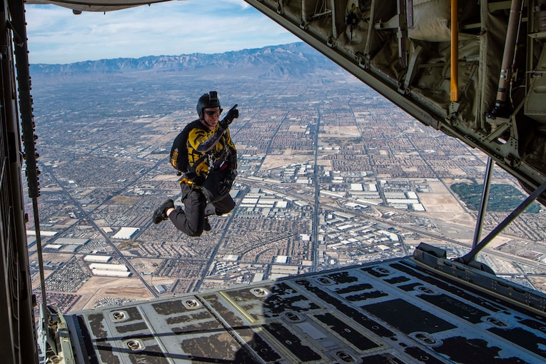 An airman jumps out of a plane.