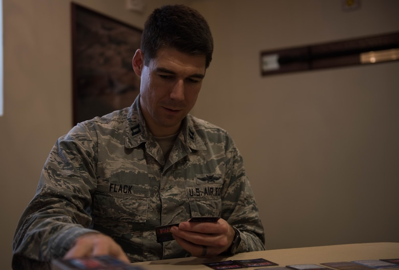 U.S. Air Force Capt. Nathaniel Flack, Department of Electrical and computer engineering student at the Air Force Institute of Technology, lays down a Battlespace Next card at Joint Base Langley-Eustis, Virginia, Nov. 18, 2019. Flack created the game to improve training within the Air Force. (U.S. Air Force photo by Airman 1st Class Sarah Dowe)