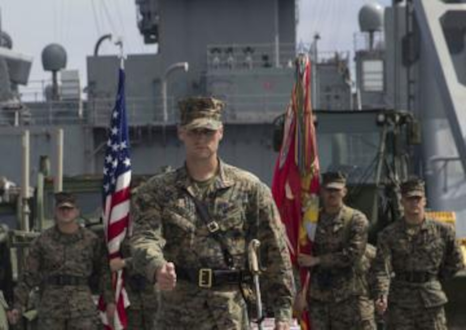 1st Lt. Michael Vazquez, with Combat Logistics Battalion 11, marches to the center of the flight deck of the USS Harpers Ferry.