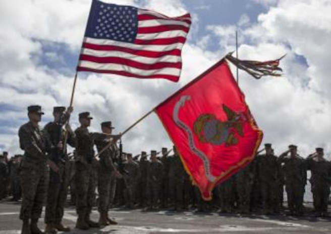 Marines with Combat Logistics Battalion 11 present colors aboard the USS Harpers Ferry.