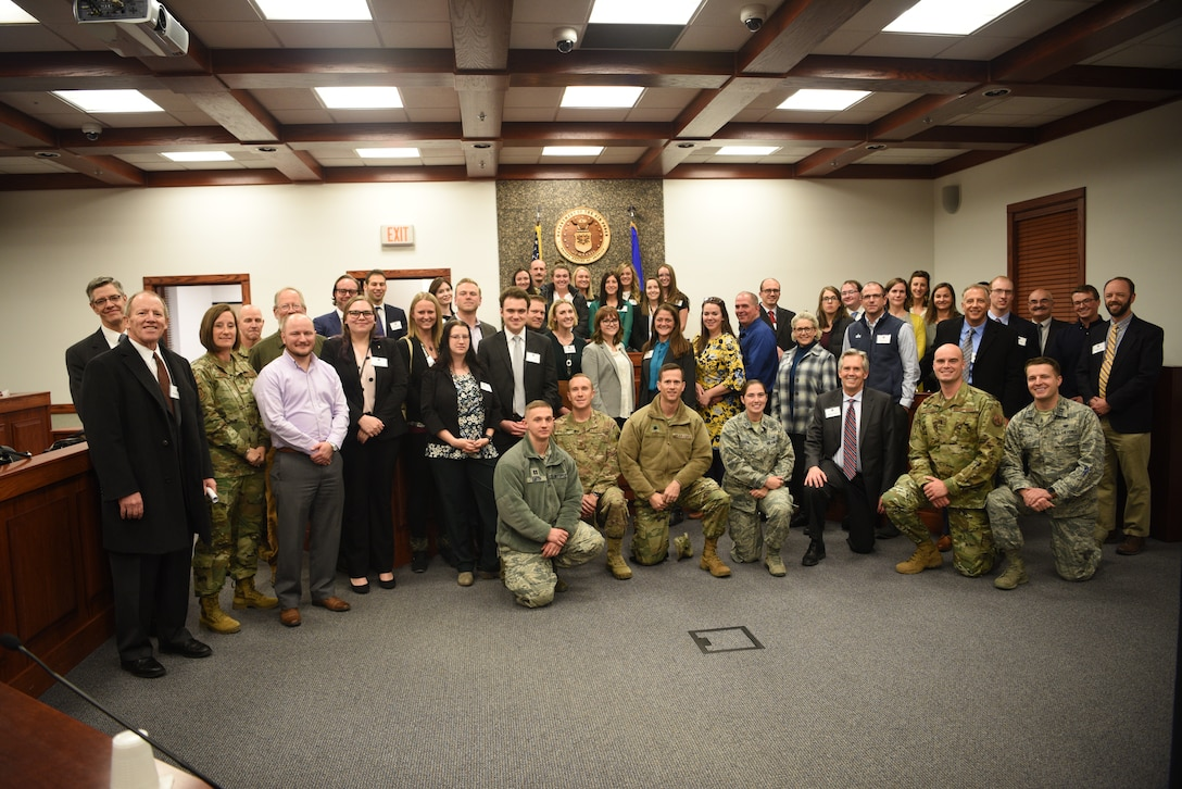 A visiting group from the local chapter of the American Inns of Court poses with members of the 90th Missile Wing's judge advocates during a tour on base Nov. 7, 2019, on F. E. Warren Air Force Base, Wyo. Members of the Inns of Court included justices from the state supreme court, law professors from the University of Wyoming, and local attorneys. The tour was intended to promote stronger relationships between the base legal professionals and their local civilian counterparts. (U.S. Air Force photo by Glenn S. Robertson).