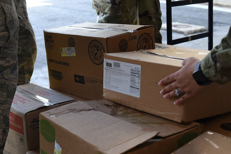 Airmen from the 81st Medical Group palletize food outside Keesler Medical Center at Keesler Air Force Base, Mississippi, Nov. 18, 2019. Team Keesler was able to salvage and donate approximately 3,000 pounds of food to local food banks from a transit aircraft en route to Honduras, which landed at Keesler due to maintenance issues. (U.S. Air Force photo by Senior Airman Suzie Plotnikov)