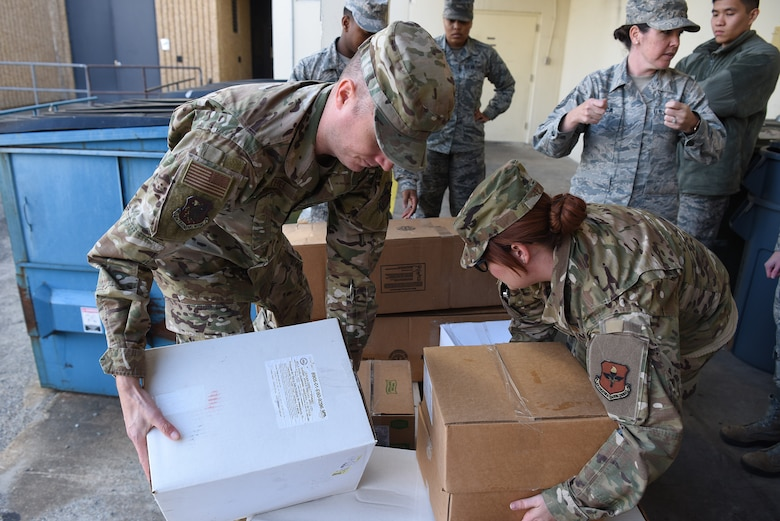 Airmen from the 81st Medical Group palletize food outside the Keesler Medical Center at Keesler Air Force Base, Mississippi, Nov. 18, 2019. Team Keesler was able to salvage and donate approximately 3,000 pounds of food to local food banks from a transit aircraft en route to Honduras, which landed at Keesler due to maintenance issues. (U.S. Air Force photo by Senior Airman Suzie Plotnikov)