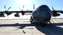 An HC-130J Combat King 2 sits on a flight line at Davis-Monthan.