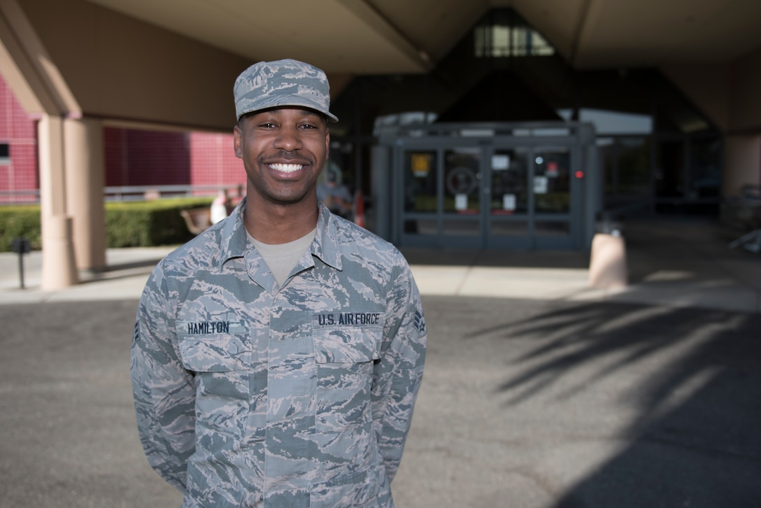 U.S. Air Force Senior Airman Andre Hamilton, 60th Medical Support Squadron health services management technician, stands in front of David Grant USAF Medical Center Nov. 19, 2019, at Travis Air Force Base, California. Hamilton was recognized as the Warrior of the Week for Nov. 17-23. The program highlights a Travis Airman for his or her outstanding performance. (U.S. Air Force photo by Airman 1st Class Cameron Otte)