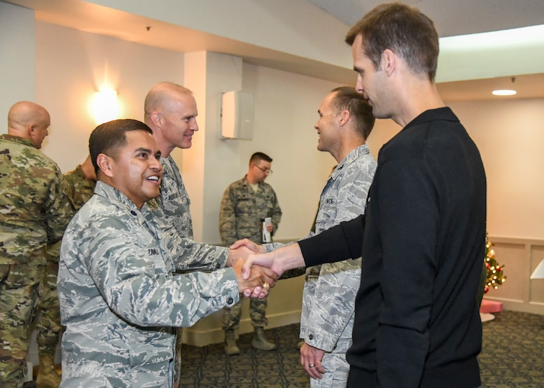 Lt. Col. Ever Zavala, Commander of Detachment 1, 47th Cyberspace Test Squadron, 96th Cyberspace Test Group, 96th Test Wing, greets members of Team Edwards following the detachment's activation ceremony at Edwards Air Force Base, California, Nov. 19. (Air Force photo by Giancarlo Casem)