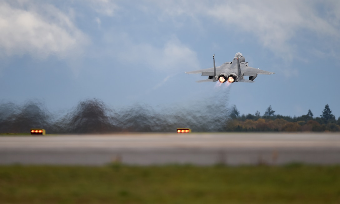 An F-15C Eagle assigned to the 493rd Fighter Squadron takes off in support of exercise Point Blank 19-8 at Royal Air Force Lakenheath, England, Nov. 14, 2019. The purpose of Point Blank is to exercise large force capabilities that incorporate current and future wartime scenarios. (U.S. Air Force photo by Airman 1st Class Madeline Herzog)
