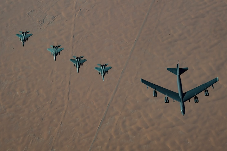 A United States Air Force B-52H Stratofortress, accompanied by four Saudi Arabian F-15C Eagles, conducts a low pass over Prince Sultan Air Base, Saudi Arabia, Nov. 1, 2019. The B-52H, deployed from Barksdale Air Force Base, La., is part of a Bomber Task Force operating out of RAF Fairford, England.