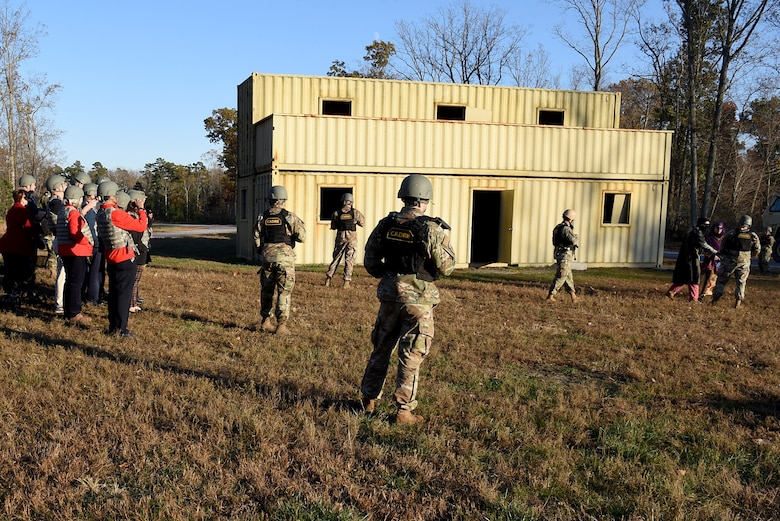 Air Mobility Command civic leaders watch asthe 421st Combat Training Squadron put on an urban operations demonstration at Home Station Training Lane West during their tour of the U.S. Air Force Expeditionary Operations School (EOS) in the U.S. Air Force Expeditionary Center, Nov. 6, 2019, at Joint Base McGuire-Dix- Lakehurst, New Jersey. The AMC civic leaders toured the EOS to see the training they provide and how they better prepare Airmen for deployments. (U.S. Air Force photo by Tech. Sgt. Ashley Hyatt)