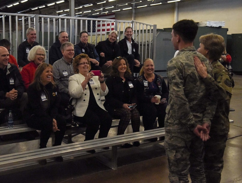 Airman 1st Class Noah Etienne, 87th Logistics Readiness Squadron Logistics Plans apprentice, is recognized by Gen. Maryanne Miller, Air Mobility Command commander, in front of AMC civic leaders at Joint Base McGuire-Dix-Lakehurst, N.J., Nov. 6, 2019, for being one of the youngest Airmen in the Air Force. Civic leaders were able to interact with Airmen and tour Joint Base MDL to better understand the mobility Airman and Rapid Global Mobility mission. (U.S. Air Force photo by Airman 1st Class Briana Cespedes)