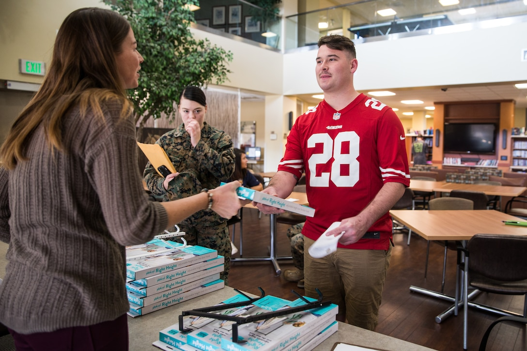 April Mitchell, entrepreneur, speaks with Marines at Wounded Warriors Battalion - West on Marine Corps Base Camp Pendleton, California, Nov. 15, 2019. Mitchell, a military spouse, created a new door hook in hopes of giving individuals with less mobility more independence. Mitchell is a native of Lake Mills, Wisconsin.