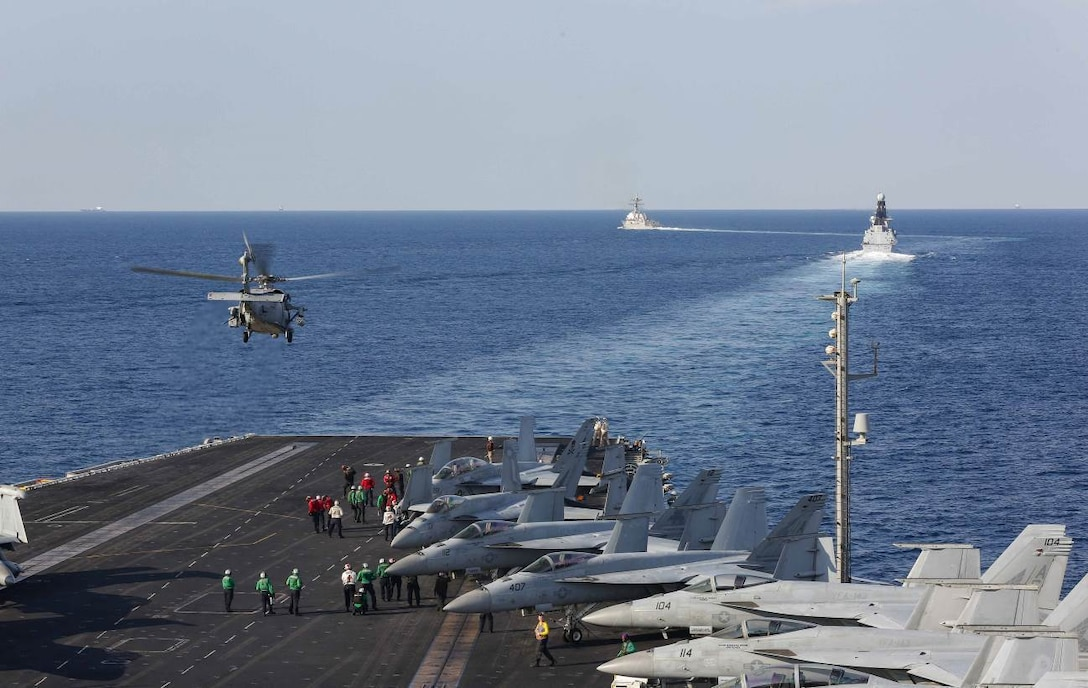 STRAIT OF HORMUZ (Nov. 19, 2019) The aircraft carrier USS Abraham Lincoln (CVN 72) transits the Strait of Hormuz as an MH-60S Sea Hawk helicopter from the Nightdippers of Helicopter Sea Combat Squadron (HSC) 5 lifts off from the flight deck. The Abraham Lincoln Carrier Strike Group is deployed to the U.S. 5th Fleet area of operations in support of naval operations to ensure maritime stability and security in the Central Region, connecting the Mediterranean and the Pacific through the western Indian Ocean and three strategic choke points. With Abraham Lincoln as the flagship, deployed strike group assets include staffs, ships and aircraft of Carrier Strike Group (CSG) 12, Destroyer Squadron (DESRON) 2, the guided-missile cruiser USS Leyte Gulf (CG 55) and Carrier Air Wing (CVW) 7. (U.S. Navy photo by Mass Communication Specialist Seaman Stephanie Contreras/Released)