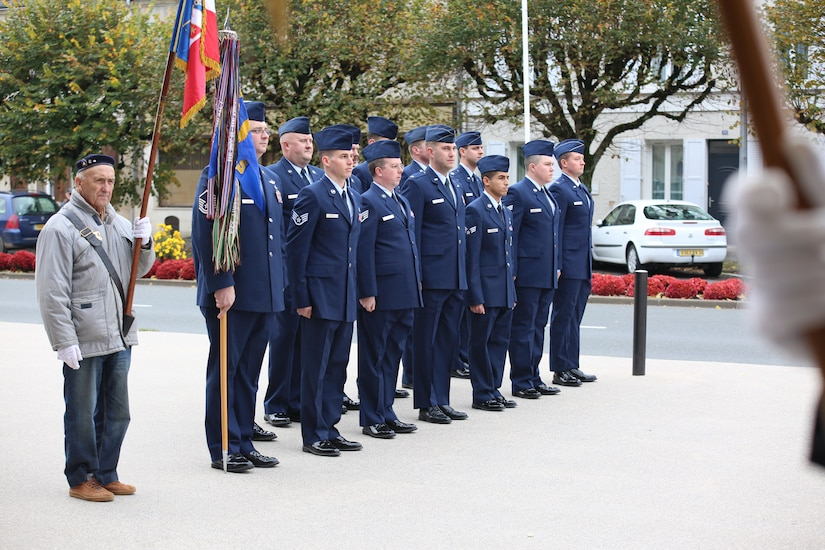 Airmen assigned to the 32nd Aerial Refueling Squadron at Joint Base McGuire-Dix-Lakehurst, New Jersey, stand in formation during an an Armistice Day ceremony Nov. 11, 2019, in Issoudun, France. The Airmen helped commemorate the day and honor fallen Airmen who were stationed at the 3rd Aviation Instruction Center during World War I. (U.S. Air Force photo by Master Sgt. John Bloomer)