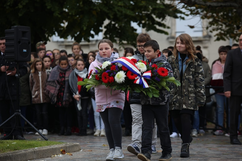 Local school children prepare to lay a wreath during an Armistice Day ceremony Nov. 11, 2019, in Issoudun, France. Villages and cities throughout France commemorated Armistice Day, which marks the armistice signed between the Allies and Germany for the cessation of hostilities in World War I. (U.S. Air Force photo by Master Sgt. John Bloomer)