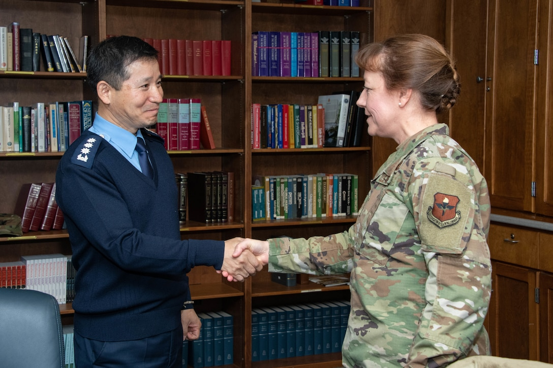 Col. Terri Jones, the Eaker Center for Leadership Development commander, greets Chaplain Kwang-Nam Na, Republic of Korea Air Force Chief of Chaplains, before providing an Eaker Center mission brief during a visit to Air University Nov. 14, 2019, at Maxwell, Air Force Base, Alabama. The visit was meant to showcase the commitment both parties have toward strengthening their existing alliance.