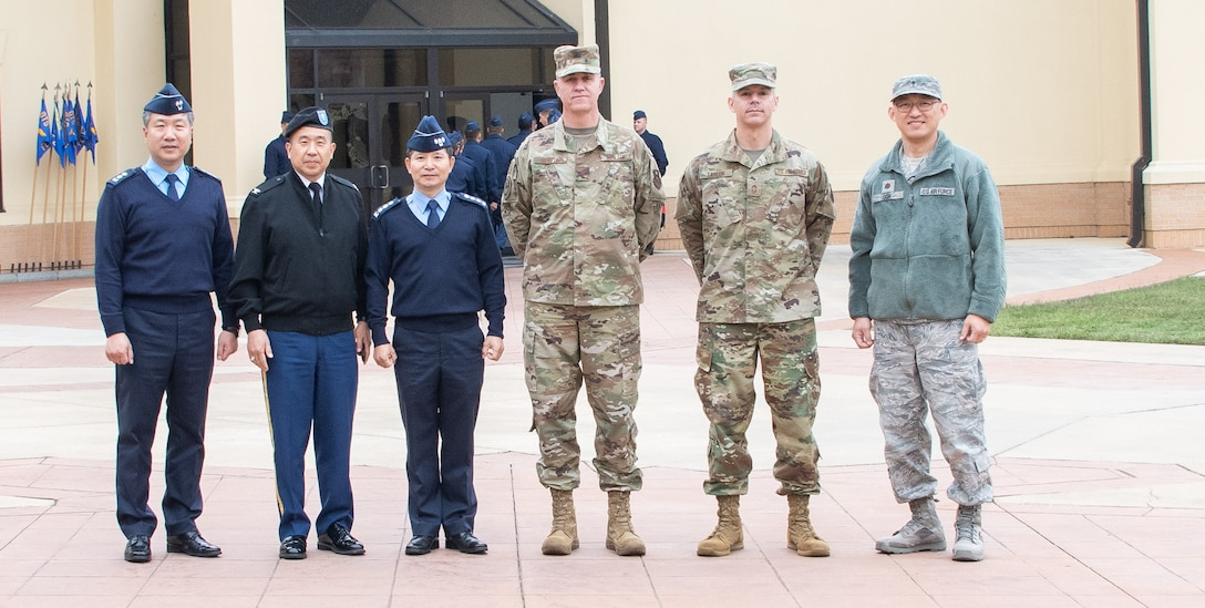 Chaplain, Lt. Col. Ilwoo Lee, Republic of Korea Air Force, upcoming ROKAF Chief of Chaplains, Chaplain, Col. Samuel Lee, United Nations Command, Combined Forces Command and United States Forces Korea Command chaplain, Chaplain, Col. Kwang-Nam Na, ROKAF Chief of Chaplains, Chaplain, Col. Michael Newton, Air Force Chaplain Corps College Commandant; Chief Master Sgt. Michael Taylor, AFCCC chief, Chaplain, and Maj. Shin Soh, interpreter, stand together during Na's visit to Air University Nov. 13-15, 2019, at Maxwell, Air Force Base, Alabama. The visit, as a whole, was held to signify their commitment to strengthening national and functional alliances in support of the Secretary of the Air Force's priorities.