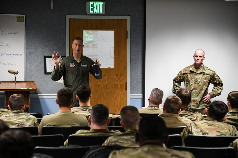 388th Fighter Wing Vice Commander Col. Michael Ebner speaks to deployiong Airmen at Hill Air Force Base, Utah on Nov. 14, 2019. The 34th Fighter Squadron departed Hill for Al Dhafra Air Base, United Arab Emirates, to support the United States Air Force Central Command mission in the MIddle East. The group of deploying Airmen was made up of pilots from the active duty 34th Fighter Squadron and Reserve 466th Fighter Squadron, as well as active duty and Reserve Airmen in the 34th Aircraft Maintenance Unit, and personnel in other support functions. (U.S. Air Force photo by R. Nial Bradshaw)