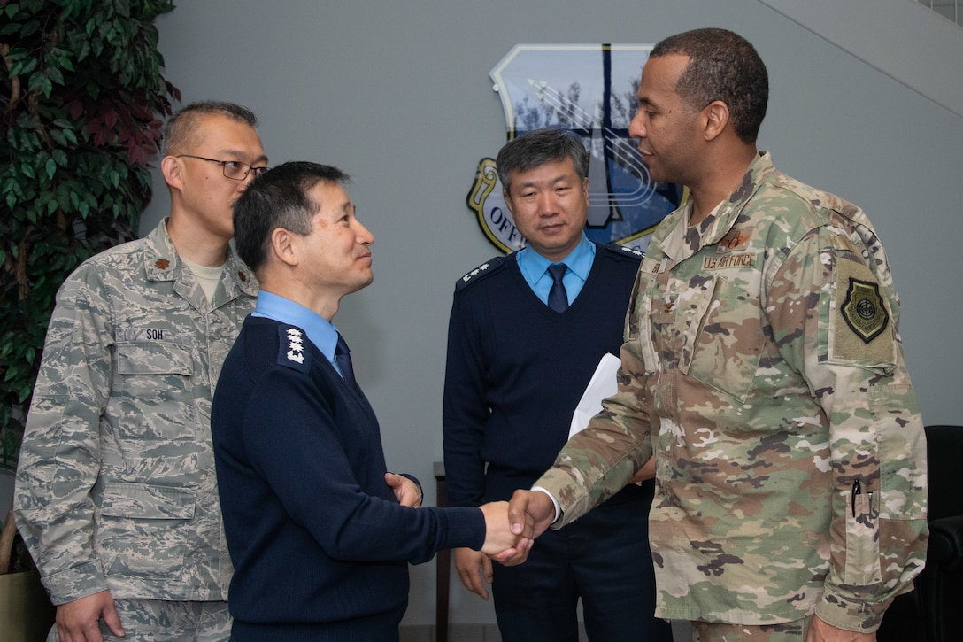 Chaplain, Col. Kwang-Nam Na, Republic of Korea Air Force Chief of Chaplains extends gratitude to Col. Peter Bailey, Officer Training School commandant, for providing an OTS mission brief and campus tour during Na's visit to Air University Nov. 13-15, 2019, at Maxwell, Air Force Base, Alabama. The visit, as a whole, was held to signify their commitment to strengthening national and functional alliances in support of the Secretary of the Air Force's priorities.