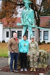 From left to right: PV2 Hunter White, PV2 April Talaiga and Staff Sgt. Marilyn Gerhardt stand with the Minuteman statue at Camp Murray Nov. 17, 2019. The couple joined the Guard together on Oct. 30, 2019.