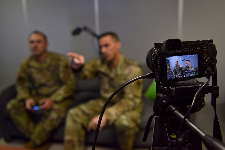 Chief Master Sgt. Dustin Hall, 9th Reconnaissance Wing command chief, and Chief Master Sgt. Trey Walker, 480th Intelligence, Surveillance and Reconnaissance Wing command chief, live-streamed while playing a video game at Beale Air Force Base, Calif., Nov. 6, 2019. The stream was part of Walker's visit to meet Airmen and communicate the future of the 548th ISR Group mission. (U.S. Air Force photo by Senior Airman Valentina Viglianco)