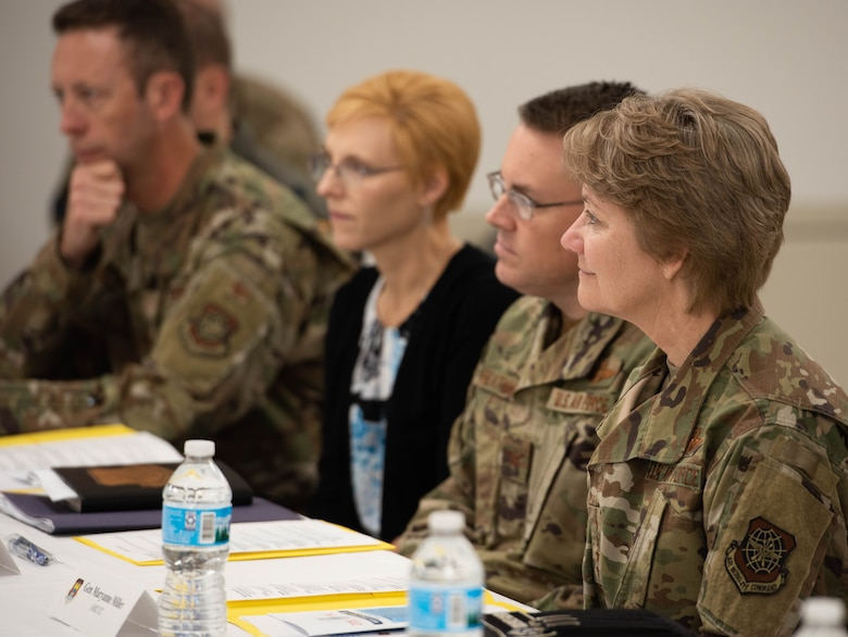 Gen. Maryanne Miller, Air Mobility Command commander, and Col. J. Scot Heathman, 375th Air Mobility Wing commander, speak with representatives from various helping agencies at Scott Air Force Base, Ill., Nov. 18, 2019.