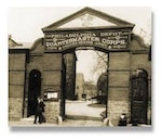 A view of the gate at the Philadelphia Quartermaster Depot at its original location where the DLA Troop Support Product Test Center Analytical mission began in 1919.