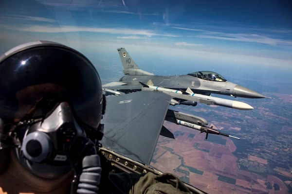 U.S. Air Force Senior Airman George Rahe, 54th Operations Support Squadron Aircrew Flight Equipment Airman, takes a selfie during a familiarization flight in an F-16 Fighting Falcon during a temporary duty assignment with the 8th Fighter Squadron, March 29, 2019 to April 12, 2019, at Naval Air Station Joint Reserve Base New Orleans, La. Many personnel were given the opportunity to go on a FAM ride in the back of an F-16 D-model during the TDY. (Courtesy photo for Senior Airman George Rahe)